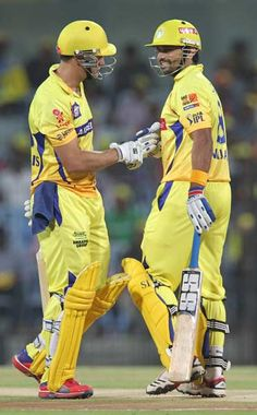 Chennai Super Kings batsmen Murali Vijay (L) and Faf du Plessis (R) interact during the IPL Twenty20 cricket match between Chennai Super Kings and Deccan Chargers at The M.A. Chidambaram Stadium in Chennai on May 4, 2012.