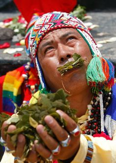 Too much coca, perhaps? A shaman holds up coca leaves during a ritual for good luck in 2012 in Lima, Peru Picture: Karel Navarro/AP