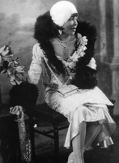 african-american flapper with fur collar coat. in a word, stunning. #blackbeauty