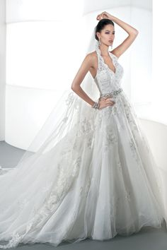 An incredible lace halter wedding gown by Demetrios.