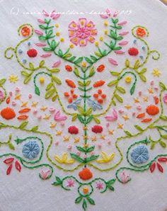 beautiful emboidery reminiscent of PA German folk art