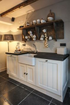 Love the farmhouse sink with the white cabinets & dark countertop. And the floor!!