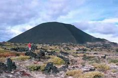 Eve Cone: Eve Cone is a black, symmetrical volcano that is estimated to have formed about 1,300 years ago. It stands out from a perfectly level plateau in Mt. Edziza Provincial Park.