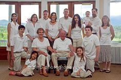 Large indoor extended family portrait More