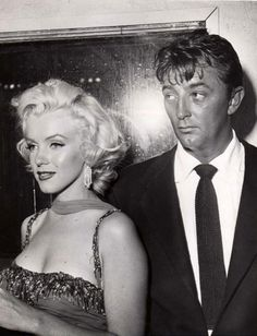 Marilyn Monroe; Robert Mitchum;  1954...Live your life to the Max! Go to www.mymillionairesocietypartners.com...and learn how you could CHANGE your life for ever!