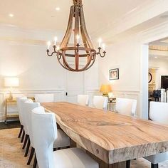 Natural wood dining room table with wine barrel stave chandalier. Rustic french country dining room - Home decor and design Wooden Dining Tables, Dining Table Design, Large Dining Room Table, Natural Wood Dining Table, Dining Area, Rustic Wood Dining Table, Table Lamps, 12 Person Dining Table, Kitchen Rustic