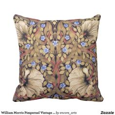 William Morris Pimpernel Vintage Floral Throw Pillow - This rich William Morris floral design adaptation makes a beautiful accent pillow. Colors include shades of light brown/tan, blue and reddish brick. Sold at Encore_Arts on Zazzle.