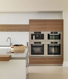 contemporary white and wood kitchen | block of Miele appliances #miele #kitchens: