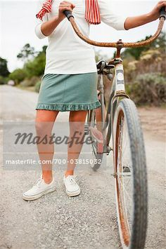 c73f390aa61 Stock photo of Woman with Bicycle Stock Photo; Premium Rights-Managed, 700-