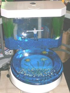Mr. Rooter is in the tank keeping it clean! Side note: isn't this toilet awesome?!