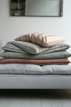 Scandi Vintage Pillows in Ticking Fabric I Remodelista. Scandi Vintage Pillows in Ticking Fabric I Remodelista. Scandinavian Fabric, Bed Pillows, Cushions, Pillow Room, Bed Linens, Ticking Fabric, Ticking Stripe, Woven Fabric, Linens And Lace