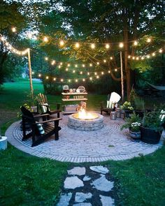 This #backyard set up is perfect for the #warm weather coming up! #backyardinspiration #homedecor #stringlights #outdoors #firepit #comfy #cozy #plants #adirondackchairs