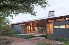 Contemporary Texas-style dogtrot house. Walls could be stone instead and feel more grounded with the earth.