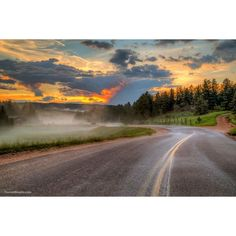 July sunset in Woodland Park, Colorado. Photo by Forrest Boutin. #sunset #Colorado #road #sky #sun #clouds #orange #yellow #nature #hiking #mountains #photography #perspective #exposure #angle #HD