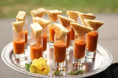 mini grilled cheese sandwiches served with shots of tomato basil soup - the perfect wedding appetizer