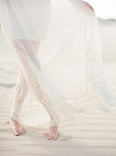 with sand between her toes.