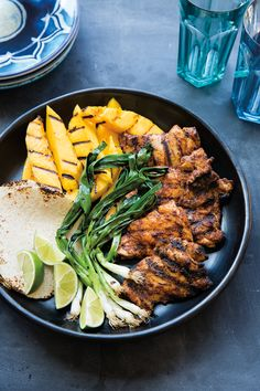 Grilled Chicken and Mango Tacos | Sweet mangoes are even more luscious and juicy when they are heated on the grill, which caramelizes their sugars.