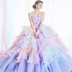 Love at first sight with this Kiyoko Hata pastel gown featuring delicately feminine embellishments!