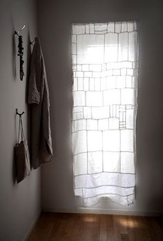 The home of Yumiko Sekine of Fog Linen Work - linen patchwork curtains. Via Design Sponge