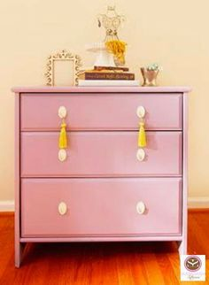 Personalize your space this spring by introducing new colors and finding alternative uses for everyday items.  A fresh coat of paint and bright yellow tassels gives this dresser the perfect dose of spring flair while the porcelain cake plate from HomeGoods displays favorite necklaces. #decorating #spring #HomeGoods #HappybyDesign