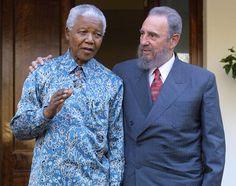 Cuban president Fidel Castro expresses his joy in meeting former South African president Nelson Mandela at Mandela's office in Johannesburg on September