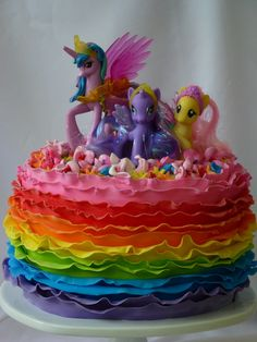 My daughter turned three and requested a My Little Pony cake with rainbows.  The toppers are My Little Pony figures for her to keep