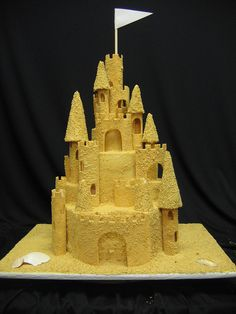 Sandcastle Cake by Classic Cakes..havn mermaid party?? Have your cake look like ariels sandcastle....what a great idea!!