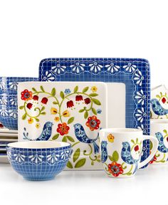 """The blue trellis and bird designs of Laurie Gates' Petra dinnerware set lend garden-fresh charm to the casual table. Hardy earthenware appeals in bold silhouettes boasting dishwasher-safe durability.  Earthenware  Dishwasher safe; microwave safe on low settings  Imported  Includes 4 of each of the following: 10.75"""" dinner plates, 8.5"""" salad plates, 5.75"""" cereal bowls and 18-oz. mugs"""