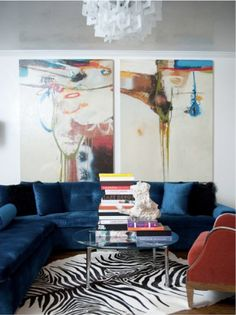 amazing art on the walls, love the rich sofa and zebra rug