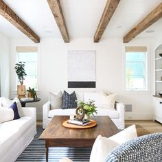 Gorgeous beams and soft colors in this airy sun-filled living room.