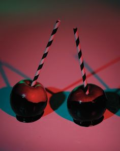 Black Candy Apples - Martha Stewart Recipes. A bit of black food coloring in the candy gives these carnival sweets a dark twist. To serve them, insert wooden sticks, and slide black-and-white straws over them