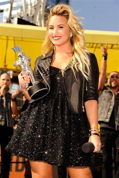 Demi Lovato arrives at the MTV Video Music Awards at Staples Center in Los Angeles on Sept. 6, 2012.