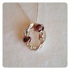 Fine silver clay pendant with bronze roses & silver detailing.