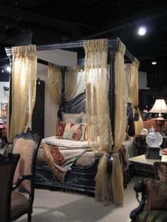 Old World Egyptian Style Black Canopy Bed. The Victorian carving and scrollwork has to go