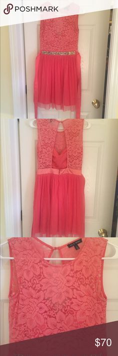 As U Wish dress Size 5, falls just above the knees/mid thigh depending on height. It is meant for juniors/teens. Excellent condition, only worn once and kept clean ever since. This dress also has a satin pink tie (hard to see in the pic) that is super cute and it meant to tie in a bow in the back. It is exactly as colored in the picture and has multiple layers, but doesn't look poofy when it's on. It also has a built in padded bra so you don't have to wear one with the dress. Hope someone…
