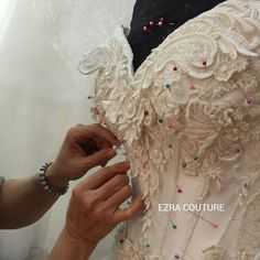 ezracouture This how we do it,all handsewn one by one 90 percent of our wedding dress is all sewn by many hands and hours to finish a dress..