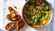 Half of the beans are mashed while the rest are left whole, giving this hearty one-pot stew a wonderfully chunky texture. Toasted ciabatta flavored with sage and garlic makes the perfect accompaniment.