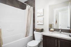 Main bath with light granite counters and dark wood cabinets Light Granite, Dark Wood Cabinets, Granite Counters, Home Builders, New Homes, Bathroom, Street, Bath Room, New Home Essentials