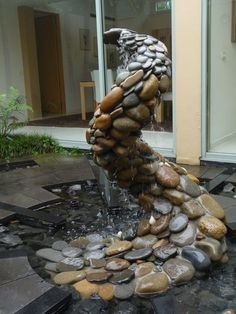 Water feature developed around a stone sculpture