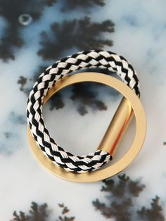 Metal and woven bracelet