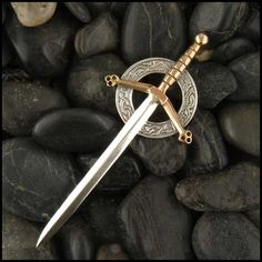 Unique sword Kilt Pin in Sterling Silver and Bronze.