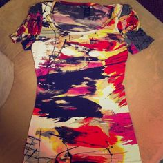 Spicy blouse! Tunic length. Looks great with a black belt/ or without. Very caliente! Shoulder pads. Very versatile. Small but fits like a medium. This top is to be worn as a form fit top. Only worn once. Bisou Bisou Tops Blouses