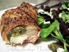 bacon wrapped chicken stuffed with cream cheese and jalapenos!! trying these tonight!