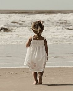 This is the age we begin our love affair with the beach! It was for me......