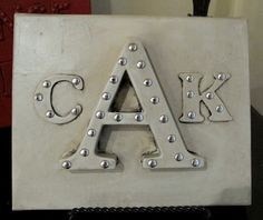 DIY Wall Art- Spray Painted Sticker Letters on Canvas