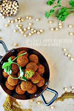 Falafels: 400 grams (2 cups) dried chick peas 1 large size onion, quatered 2 garlic clove, crushed 2 teaspoons roasted coriander, ground 1 teaspoon ground roasted cumin 1 teaspoon cayenne pepper 1 big handful each flat parsley and cilantro salt and black pepper, to taste oil for frying