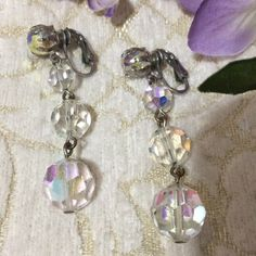 Crystal Earrings-Beautiful These beautiful crystal earrings are approximately 2 inches long, they glitter and shine with or without light. Can easily be changed to pierced earrings.    Simply gorgeous. Jewelry Earrings