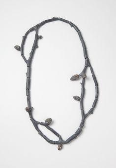 """Raduga Buds 2"", necklace, 2013. Wood, graffiti, silver, steel wire. Photo: Mirei Takeuchi"