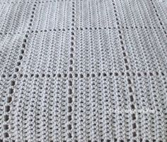 We love the Faux Square Babyghan because it looks like crochet squares but the afghan is crocheted in one piece. This baby blue blanket would make a great baby shower gift. Finish this blanket with a crochet border in a different color.