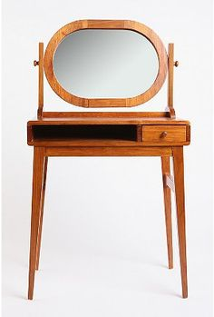 Mirror Mirror vanity table. (would be even better painted red or turquoise)
